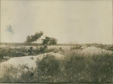 Vintage photo of soldiers in a battle ground during wartime.