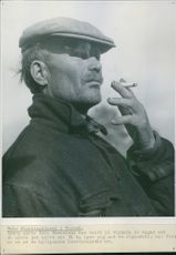 A refugee smoking cigarette in the camp Tornio. 1944