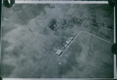 Aerial view of a huge ground and houses. 1936