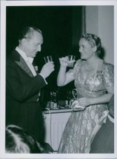Einar Beyron and Brita Hertzberg drinking and having fun at a party, 1944.