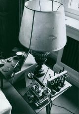 View of table lamp and other equipment on the side table.