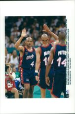 """Charles Barkley makes high five with Reggie Miller during the """"Dream Team"""" basketball match - Lithuania during the Atlanta Olympic Games in 1996"""