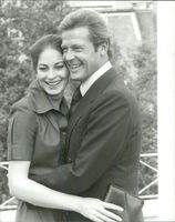 "Barbara Kellermann and Roger Moore in London in front of the recordings of the movie ""The Wolves of the Sea"""