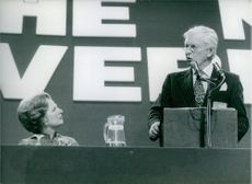 Mrs. Thatcher listens to John Davies speaking at the Conservative Party Conference in Brighton, October 1978.