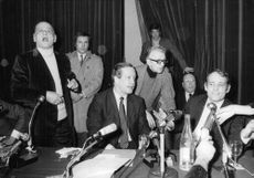 Henri Charrière delivering a speech in a press conference.