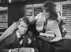 Actress Ann Smyrner and actor O.W Fischer during their scene from a German comedy Film, Breakfast in Bed.