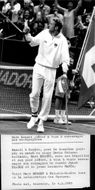 Tennis player Marc Rosset on crutches