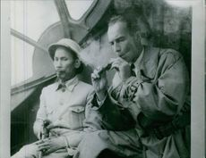Two men sitting together and smoking.  1966 Jean Sainteny, French diplomat Faith most of Ho Chi Minh
