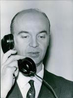 Gaston Naessens talking on the telephone. 1964.