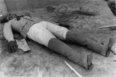 A man lying on the ground.
