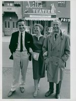 Mona Dan-Bergman flanked by two gentlemen outside the Little Theater