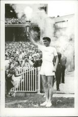 Australian athlete Ron Clarke stays in the torch during the Olympics