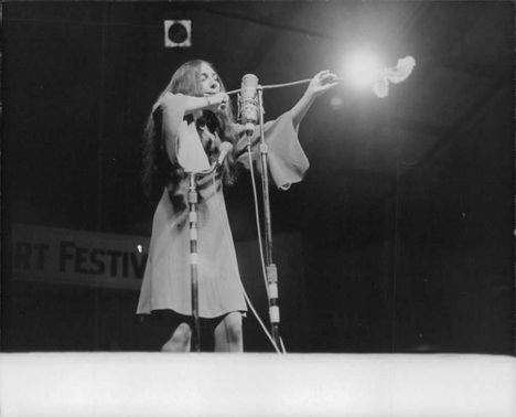 Buffy Sainte-Marie, performing on stage.