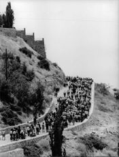 A crowd walking in a mountainous area in Israel.