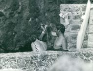 Princess Margriet and Pieter van Vollenhoven bathing.