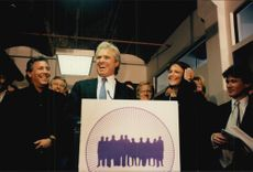 Joseph P. Kennedy II announces he leaves the policy. Next to him is his wife Beth Kelly Kennedy seen