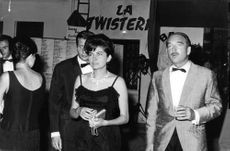 Princess Soraya with people in a party.