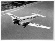 One of Lufthansa Junkers Ju 52 in the air. The plane was part of Lufthansa fleet between 1932 and 1945.