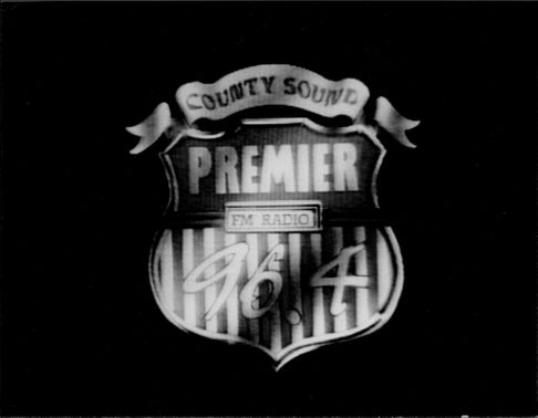 Advertising for County Sound Premier - FM Radio 96.4