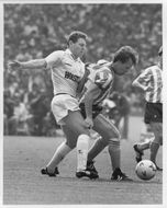 Trevor Peake and Clive Allen fight for the ball