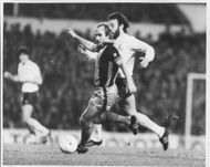 Mick Mills in action for Southampton