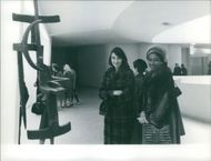 Marie-Thérèse Houphouët-Boigny and another woman in an art museum. Photo taken Nov.23, 1959