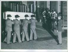 Soldiers holding and respectfully taking away the coffin of Wilhelmina.