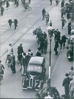 German in motorcycle patrolling in Copenhagen and men were running away from them. 1943