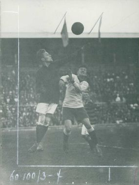 A goalkeeper trying to save the ball from the opponent.