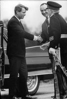 Man greeting Robert F. Kennedy.