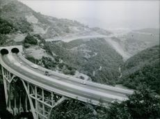 High angle view of a bridge, vehicles moving on it. 1963  Autostrador, A motorway in Italy