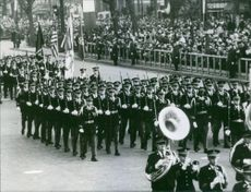 Soldiers marching in street during an event.
