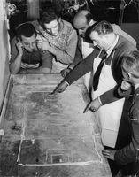 Men strategicically planning for a game match.  - 1957