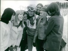 Ladies surrounding the athlete, Jean-Claude Killy.
