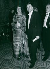 Man and woman in party. 1979