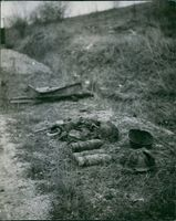 Destroyed bullets and helmets of soldiers placed on the ground in France during World War I, 1935.