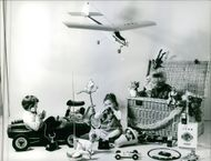 Photograph of Philippe Nicaud's wife, Christine Carère playing with their children.