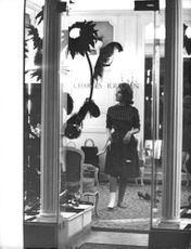 Princess Lamia Solh being photographed standing inside the Charles Jourdan shoe store