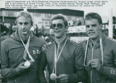 The medals of 200m butterfly at Sim-EM. Roger Pyttel (silver), Mikael Kraus (gold) and Pär Arvidsson (bronze)