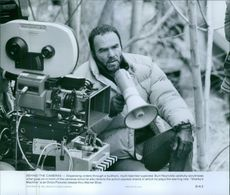 Burt Reynolds carefully scrutinizes what goes on in front of the cameras since he also directs the action-packed drama in which he plays the starring role Sharky's Machine, 1981.