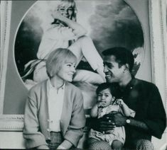 Sammy Davis Jr. with his wife May Britt and child.
