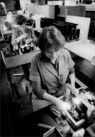 Women in production at the small company ED Liesegang, which manufactures optics