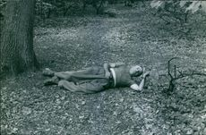 Man lying down on ground.