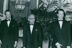 A photo of  Burmese diplomat and the third Secretary-General of the United Nations Thant, known honorifically as U Thant with Baudouin, King of the Belgians, and another man. 1968.