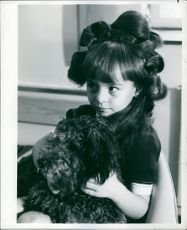 Girl with black dog.
