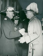King Håkon VII of Norway is welcomed at the center of Stockholm by King Gustaf VI Adolf