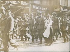 Soldiers marching together in the street during First World War, 1914.