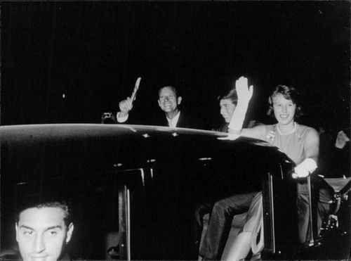 England Royal family in Jamaica On the motorcade are Prince Philip Duke of Edinburgh with his children Prince Charles and Princess Anne smiling and waving their hands