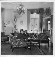 "Johan Jonatan ""Jussi"" Björling sitting with his wife in house."