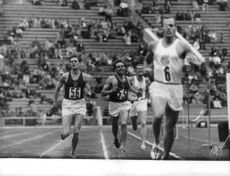 Men running race in olympiad.